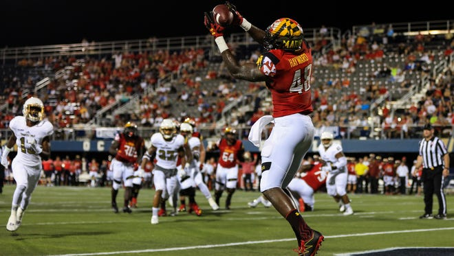 Wi-Hi graduate Derrick Hayward (48) scores a touchdown for the Maryland Terrapins during the first half of the game against the FIU Panthers at FIU Stadium on Sept. 9, 2016 in Miami, Florida.