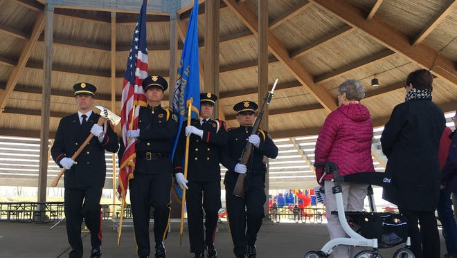 A police and fire department color guard retire the colors at South Dakota's first Worker Memorial Day, held at the Sertoma Park pavilion in Sioux Falls on Wednesday.