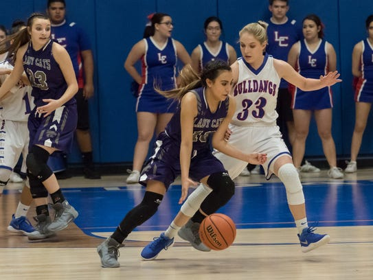 Las Cruces High School's Sarah Abney puts the pressure