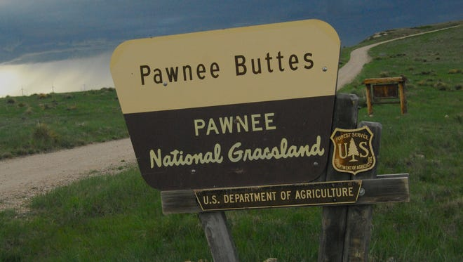 A sign marks the entrance to Pawnee National Grassland. Congress is considering how to fund a program that pays counties for federal lands within their boundaries.