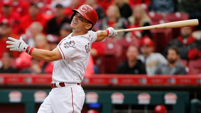 Cincinnati Reds second baseman Scooter Gennett (4) hits a home run in the ninth inning during the National League baseball game between the Philadelphia Phillies and the Cincinnati Reds, Monday, April 3, 2017, at Great American Ball Park in Cincinnati.