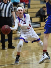 Reed's Mikayla Shults passes ball against Reed during