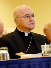 Archbishop Carlo Maria Vigano, Apostolic Nuncio to United States, listens to remarks at the United States Conference of Catholic Bishops' annual fall meeting, Monday, Nov. 16, 2015, in Baltimore. (AP Photo/Patrick Semansky)