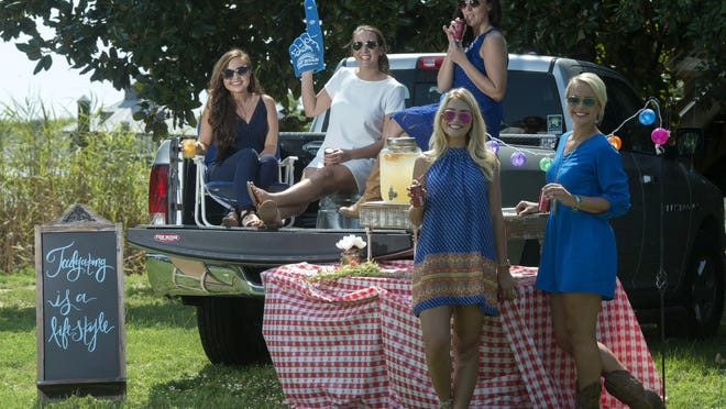 Taylor Dawson, Laurel Woodfin, Ashley Bliss, Melissa Bailey, and Rylee Hart throw the perfect tailgating party.