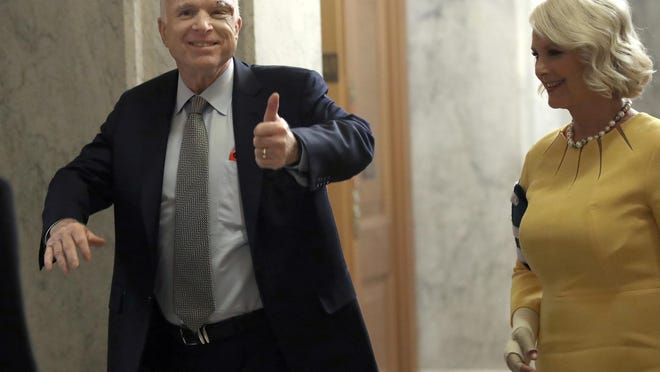 """Sen. John McCain returned to Washington, D.C., with his wife, Cindy, on the day the U.S. Senate was to hold a key procedural vote on President Donald Trump's effort to repeal and replace the Affordable Care Act. McCain voted no on the """"skinny repeal,"""" which was defeated."""