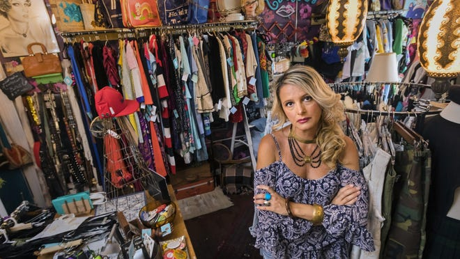 Heidi Ferguson stands in her shuttered vintage store, Stitches and Rust, on J Street in downtown Lake Worth Beach, Thursday, April 16, 2020. She is one of the sole proprietor businesses that are left out on small business loans and assistance.
