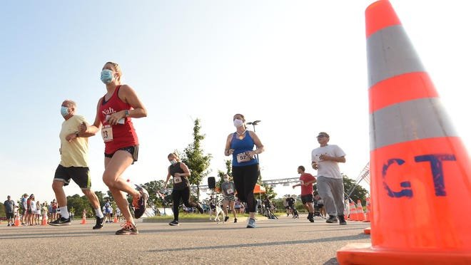 Over 150 runners take part in the Battle of Independence 5K and 1 mile run Saturday at The Pointe at Barclay.  The race was the first to have an option of running live after the COVID-19 outbreak.