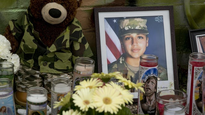 Candles and flowers are left at a mural for Vanessa Guillen at a convenience store at East William Cannon Drive and South Pleasant Valley Road in the Dove Springs neighborhood on Monday July 6, 2020.   Guillen was a soldier the U.S. Army who went missing from Fort Hood in April, and is believed to have been killed by another soldier.