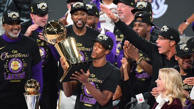 Guard Rajon Rondo raises the trophy after the Lakers defeated the Heat to win the NBA championship on Sunday. It was the second title for Rondo, who won one as a member of the Celtics in 2008.