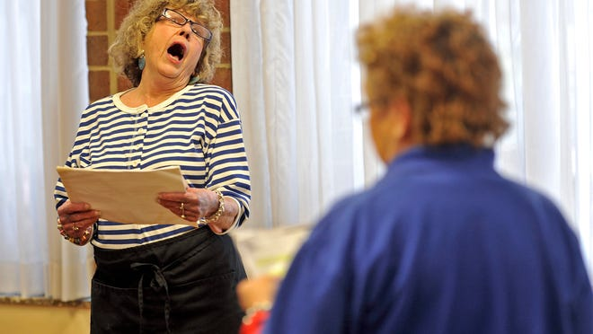 Gay Webber, left, acts during a special class for senior citizens at Villa Maria Manor in Nashville.