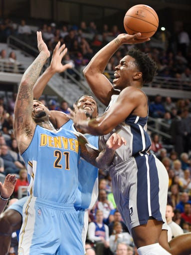 The Pistons' Stanley Johnson shoots over the Nuggets'