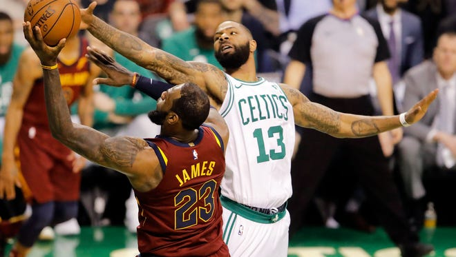 Boston Celtics forward Marcus Morris (13) defends Cleveland Cavaliers forward LeBron James (23) during the third quarter in game one of the Eastern conference finals of the 2018 NBA Playoffs at TD Garden.