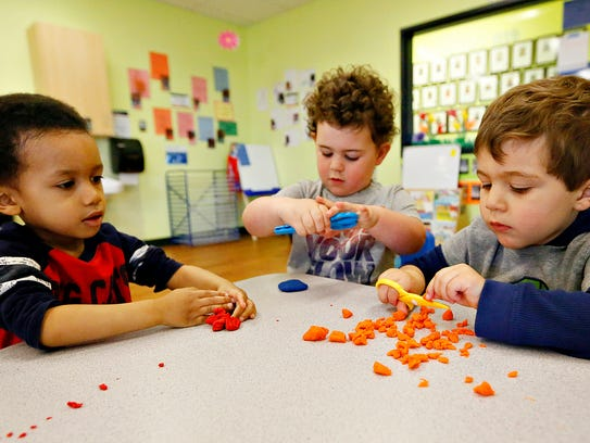 Three-year-old students, from left, Amir Russell, Everett