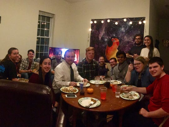 Current and former members of the University of Delaware Marching Band gather earlier this week for their annual Friendsgiving dinner in Newark.