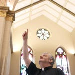 The Rev. Oliver Doyle explains the effects and severity of the water damage in St. Ann's Cathedral on Wednesday.