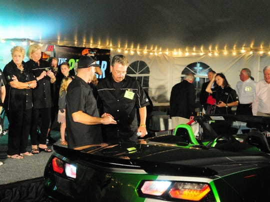 Tom Hoff and Paul Teutul Jr. speak at the unveiling of the 811 Car in Ocean City on Oct. 19.