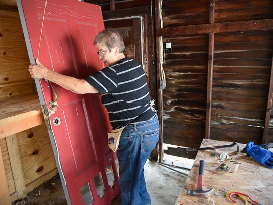 Habitat for Humanity volunteer Caroline Linz removes