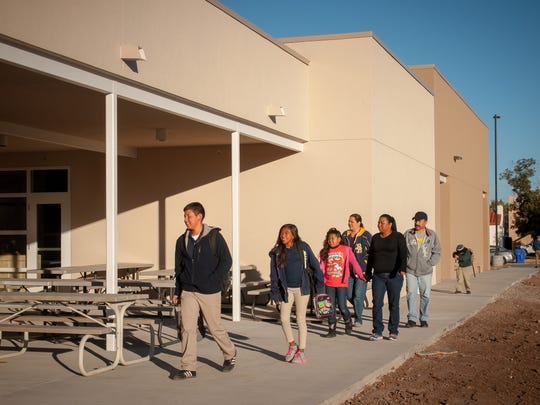 Students arrive for the first day of class at J. Paul Taylor Academy's new campus. Students, parents, teachers and staff have spent much of the week moving from the previous location, at 3900 Del Rey Boulevard, to the new school, at 410 W. Court Ave.