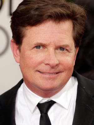 Michael J. Fox, shown in January, is teaming up with Intel in a project to use a monitor to track movements of Parkinson's patients.