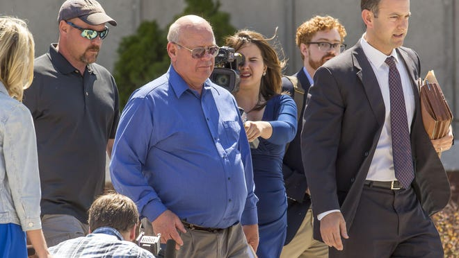 Sen. Norman McAllister, R-Franklin, center, leaves Vermont Superior Court in St. Albans in May after pleading not guilty to charges of sexual assault and prohibited acts. McAllister's colleagues in the Senate are split over whether to expel him, suspend him, or allow him to continue serving if he chooses to do so.