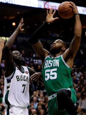 FILE - In this April 20, 2018, file photo, Boston Celtics' Greg Monroe shoots past Milwaukee Bucks' Thon Maker during the second half of Game 3 of an NBA basketball first-round playoff series, in Milwaukee. As much as teams put effort into developing plans for acquiring talent via the draft, free agency or trades, sometimes a late pickup can become a piece that helps complete the puzzle. The Celtics signed Monroe after he was waived by the Phoenix Suns.  (AP Photo/Morry Gash, File)