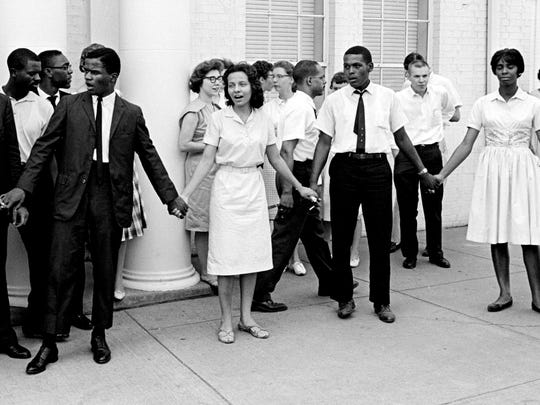 Demonstrators are singing as the have a sit-down strike in front of the Nashville Police Department Aug. 7, 1961, as they protest what they called police brutality in a racial clash two nights before. Diane Nash, center, a leader in the group, was one of seven blacks arrested in the clash with a group of white youths.