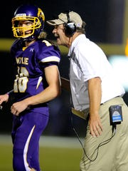 Wylie head coach Hugh Sandifer sends in a play with quarterback Blake Frampton (18) during the fourth quarter of the Bulldogs' 38-16 win on Friday, Sept. 20, 2013, at Wylie's Bulldog Stadium.