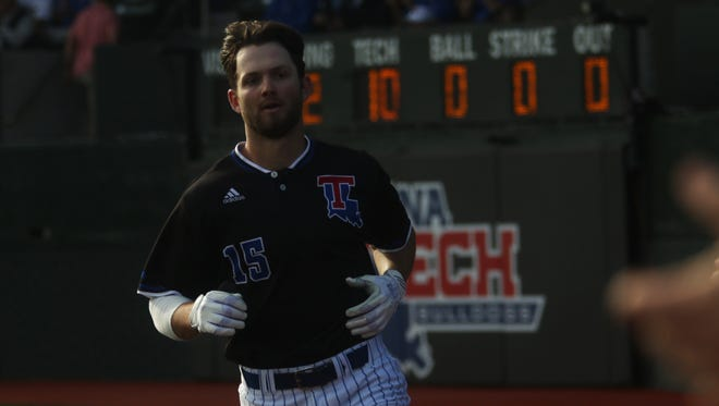 Sean Ullrich jogs back to the dugout after making it home during Louisiana Tech's second game against Arkansas at J.C. Love Field in Ruston on Wednesday, March 1, 2017. The Bulldogs lost 13-10.
