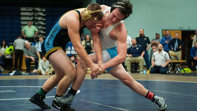MMU's Colby Giroux and Essex's Jack Carney wrestle during the Michael J. Baker wrestling tournament at Essex High School on Saturday afternoon January 20, 2018 in Essex.