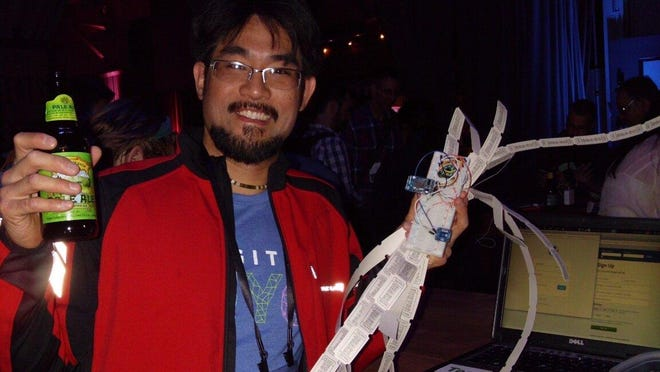 David Nghiem after he won hackathon with his newly-created monitoring device