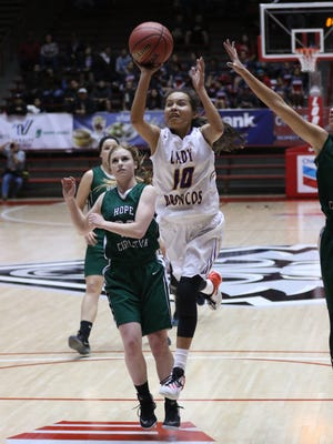 Kirtland Central's Haile Gleason drives past Hope Christian's Christine Heisey for a jumper during their 4A quarterfinal game Tuesday at The Pit in Albuquerque.