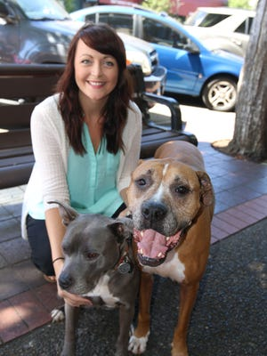 Jennifer Gallardo holds doggy ambassadors Berry (left) and Max. Born Again Pit Bull Rescue will hold a dog wash Sunday in West Salem.