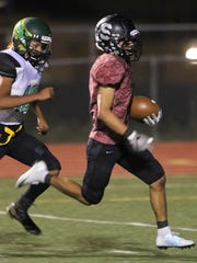 ​Shiprock receiver Brandon Lapahe completes a 49-yard pass play in the third quarter of Friday's game in Shiprock.