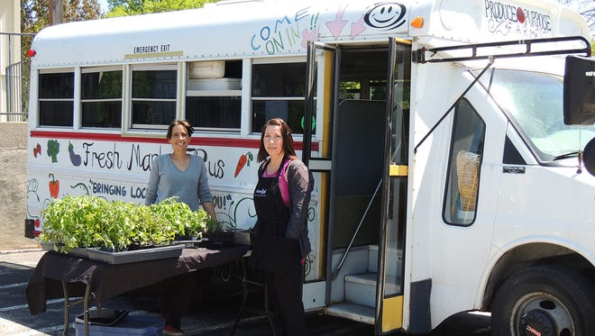 Terri Deanovich, owner of Urban Fuel Café, welcomes Tonya of Produce with Purpose, to the Old Mill Plaza in Peebles.