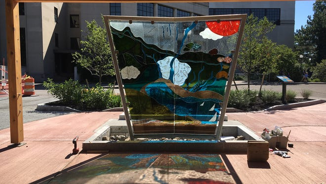 Nancy Gong's glass art tells the story of the Rochester Museum & Science Center landscape.
