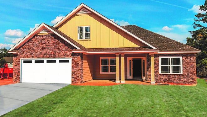 This home is located in Meadow Ridge in Buck Lake. It features three bedrooms, two bathrooms. It's one of nearly two dozen homes featured in this year's Parade of Homes.