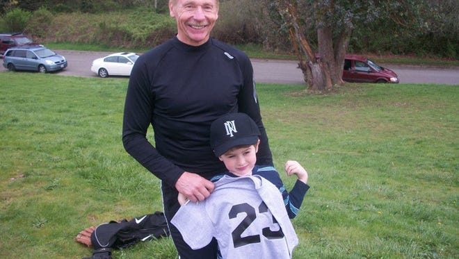 John Sitton and his grandson, Preston. Sitton was a long-time coach and educator in Central Kitsap, and in retirement works just as hard keeping up with family.