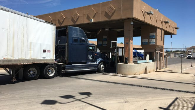 A truck pulls into the initial inspection station at the Douglas commercial shipping port. Inspectors from both countries cut down on delays by inspecting the trucks together rather than forcing drivers to be subjected to two separate inspections.