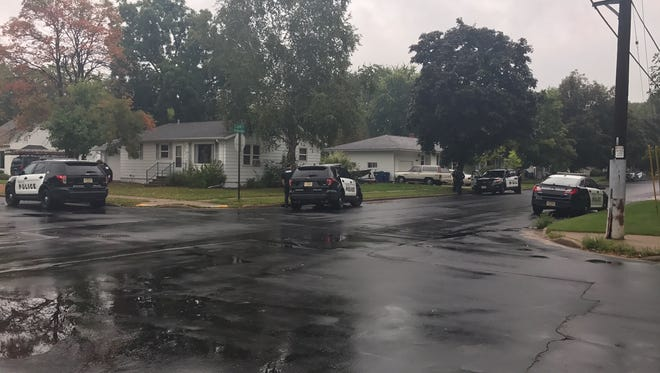 Police surrounded a home at 10th and McIntosh streets in Wausau early on Sunday, Aug. 27, 2017, after reports of shots fired. One male was arrested. No one was injured.