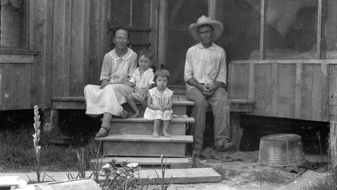 """What appears to be grandparents, or maybe even parents who have had a hard life, sit with two children on the steps of a porch in this """"Doc"""" McGregor photo taken on Jan. 31, 1930, in the second year of the Great Depression. The photo has the kind of appeal found in Walker Evans' photos in 'Let Us Now Praise Famous Men' of sharecroppers in Alabama in 1936."""