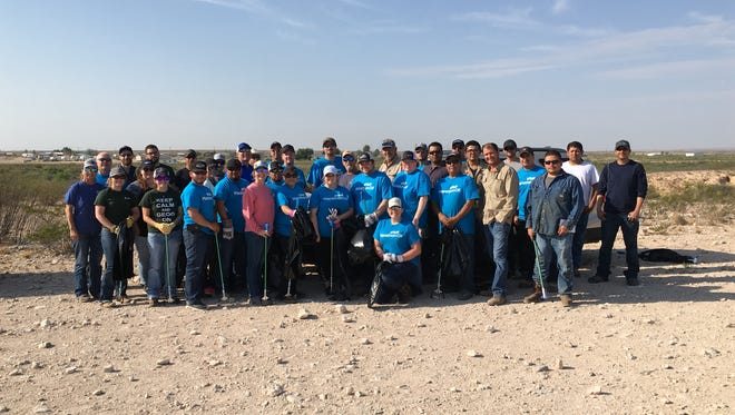 Employees of the New Mexico Bureau of Land Management, Marathon Oil and Wescom Inc. June 8 at the trailhead of La Cueva Trails in Carlsbad, New Mexico.