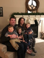 Laura Colbert with her husband, Garrett, and children.