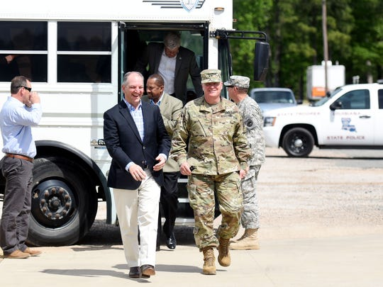 Louisiana Governor John Bel Edwards, left, walks with Maj. Gen. Glenn H. Curtis, Adjutant Gen. for the Louisiana National Guard, as they finish up their tour of Camp Minden Friday afternoon.
