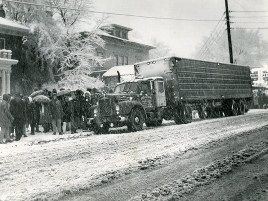 A crowd gathers around the scene of the shooting of University of Tennessee student Marnell Goodman, 18. Truck driver William Douglas Willett Jr. fired a .22 caliber pistol when Goodman and other students pelted his produce truck with snowballs on Cumberland Avenue on Feb. 1, 1965.