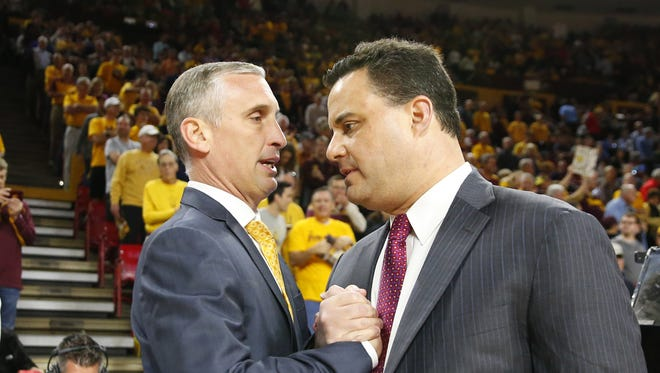Arizona State Sun Devils head coach Bobby Hurley and Arizona Wildcats head coach Sean Miller talk before a men's basketball game at Wells Fargo Arena in Tempe on February 15, 2018. #asu basketball