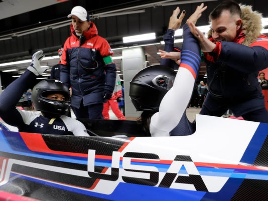 Driver Elana Meyers Taylor and Lauren Gibbs of the United States celebrate after their silver medal winning heat during the women's two-man bobsled final at the 2018 Winter Olympics in Pyeongchang, South Korea, Wednesday, Feb. 21, 2018. (AP Photo/Wong Maye-E)