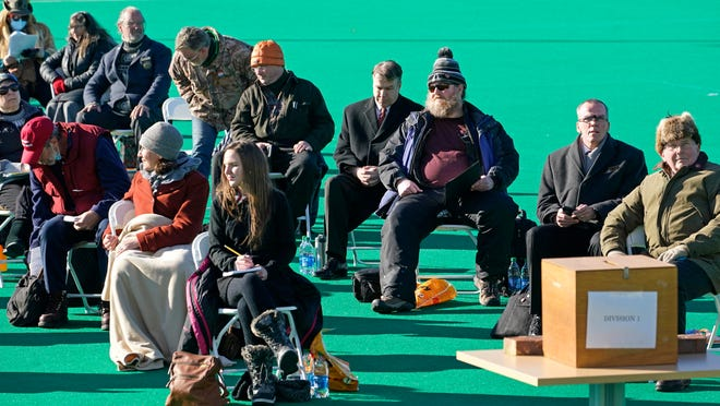 A section of New Hampshire lawmakers sit without face masks during an outdoor session Wednesday at the University of New Hampshire in Durham, N.H.