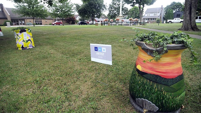 This is the rain barrel painted by Lara Spreng for the Ashland Soil and Water Conservation District's Rain Beat on Main Street project seen here Thursday on display in Loudonville's Central Park with the nine other rain barrels from other artists. The rain barrels will be on display in Loudonville's Central Park until Aug. 11 and then they will be on display at Corner Park in Ashland from Aug. 13-25.