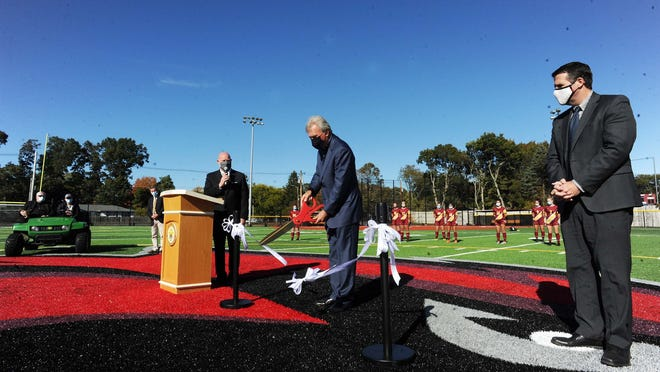 Kevin Kelley, Chairman of the Board, and Mayor Robert Sullivan are shown helping to unveil the new Cardinal Spellman High School turf field in a ribbon-cutting ceremony in Brockton on Friday, Oct. 9, 2020.  Marc Vasconcellos/The Enterprise)