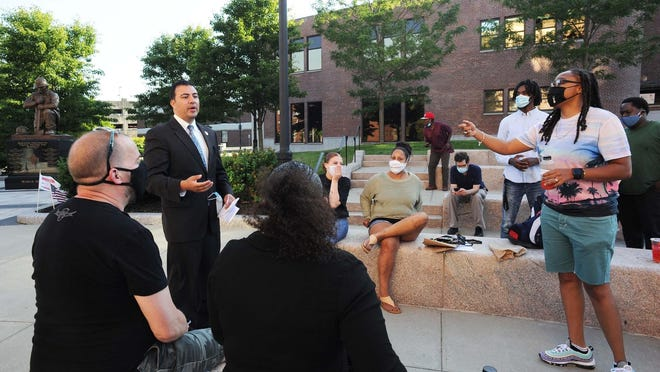 Bri Nichols, right, has questions for Ward 5 city councilor Jeffrey Thompson, left, during a peaceful gathering of Brockton citizens for the defunding of the Brockton Police Department outside Brockton City Hall on Wednesday, June 24, 2020.